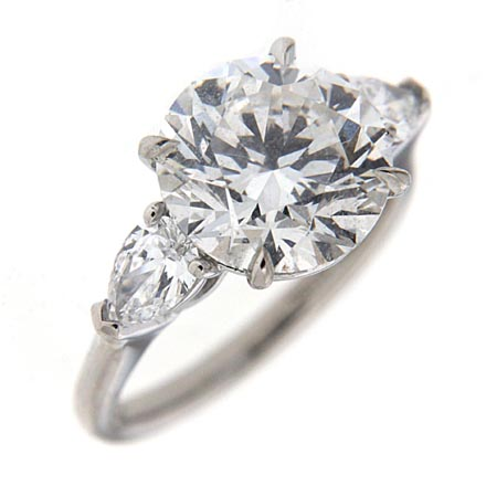 Round brilliant engagement ring with side stones
