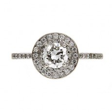 Round brilliant cut diamond engagement ring with halo diamonds