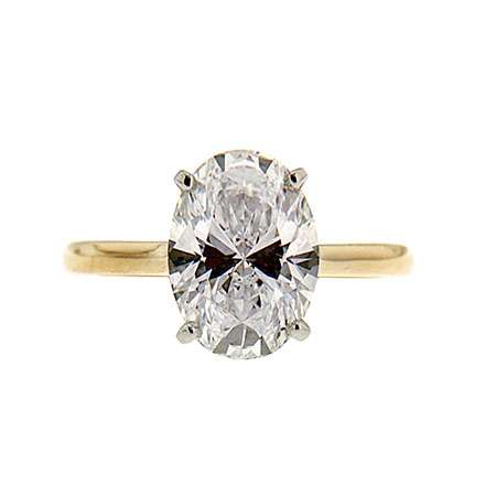 Oval cut yellow gold engagement ring