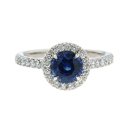 Love ring with a sapphire and diamonds all around