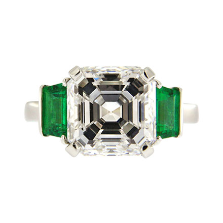 Asscher cut diamond engagement ring with emeralds on the sides